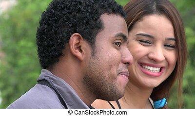 Woman Laughing At Man Telling Joke