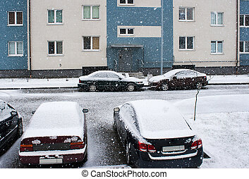 four cars near the house in the snow - four cars parked near...