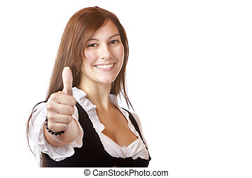 Young beautiful Bavarian woman with Dirndl dress shows thumb up
