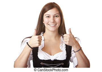 Young beautiful woman with Oktoberfest Dirndl dress shows both thumbs. Isolated on white background.