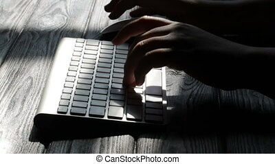 Woman hands typing