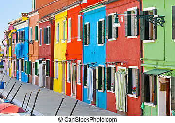 Beautiful houses - Colorful buildings in Burano island sunny...