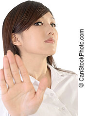 stop - Businesswoman say stop by hand on white background
