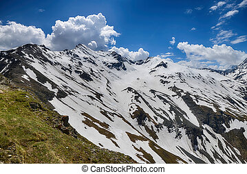 capped mountain peaks and blue sky