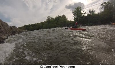 Canoeing on the rough mountain river