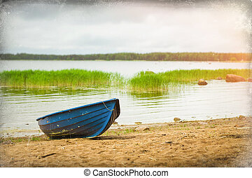 Blue boat on sandy shore Hamina camping, Finland, Suomi -...