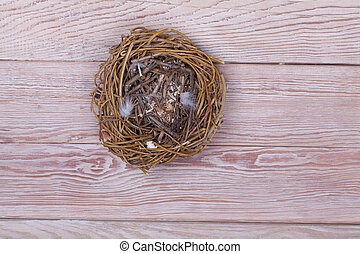 Empty birds nest on wooden background