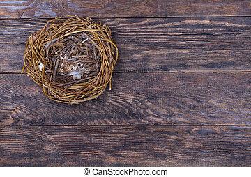 Empty birds nest on wooden background