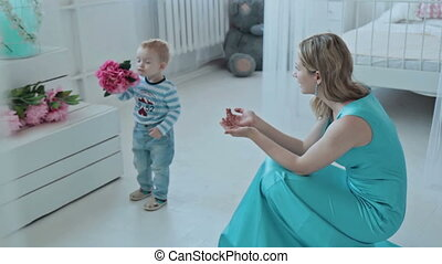 Boy offering bunch flowers for mother