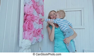 Mother playing with her son at the bedroom - Young mother...