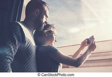Adult couple summer journey. Photo woman and bearded man...