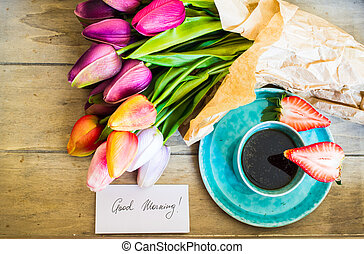 Tulips, coffee and fresh strawberries - Turquois cup of...