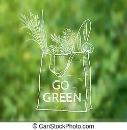 Reusable shopping eco bag on a green blurred background Hand...