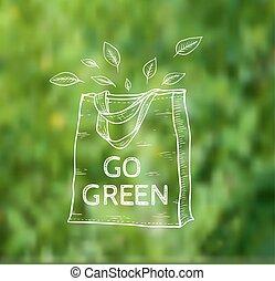 Reusable shopping bag - Reusable shopping eco bag on a green...