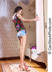 girl has opened wardrobe and hopes to find new clothes