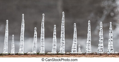 pattern of ice crystal hanging un a peace of wood
