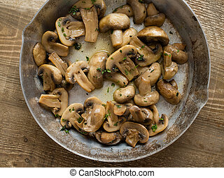 rustic sauteed mushrooms - close up of rustic sauteed...