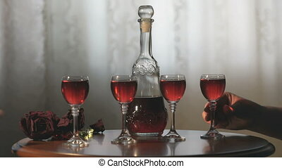 Four friends hold glasses with cranberry tincture - The four...