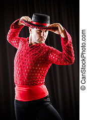 Man dancing spanish dance in red clothing
