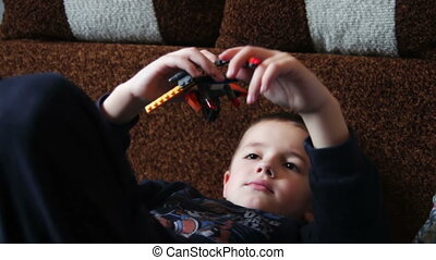 Child Boy Playing with Toys