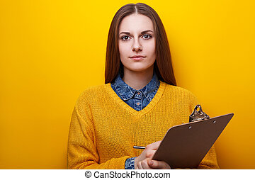 Portrait of attractive girl with clipboard - Portrait of an...