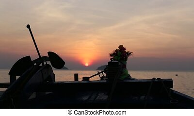 Silhouette of thai fishing boat on the sea coast during...