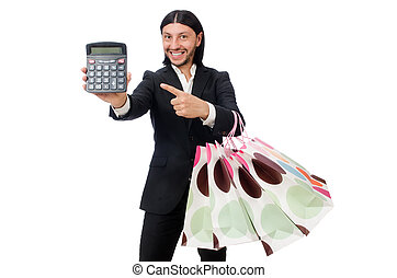 Man holding plastic bags and calculator isolated on white
