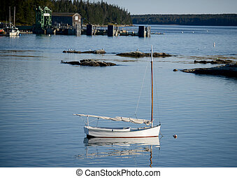 Sailboat in quaint and rural  fishing village