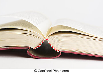 An open red hardcovered book, on white background