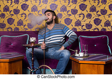 Man Smoking Shisha At Arabic Restaurant - Young Man Smoking...
