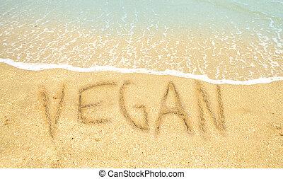 Vegan word written on beach - Vegan written in the sand on a...