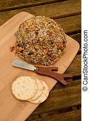 Cheese ball on cutting board - Gourmet cheese ball and...