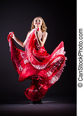 Young woman dancing in red dress