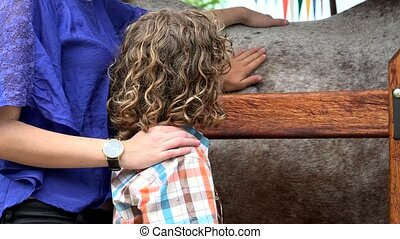 Brother And Sister Petting Horse