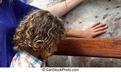 Young Boy Petting Horse