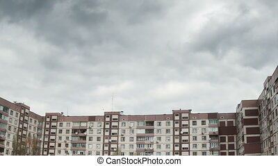 Clouds Moving over the Multistorey Buildings Time Lapse -...