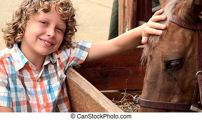 Boy At Horse Farm