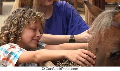 Siblings With Farm Horse