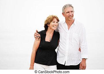 Beautiful mature couple walking