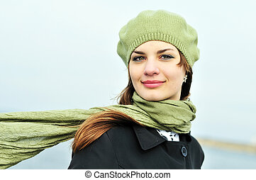 windy day - attractive teenage girl wearing beret standing...