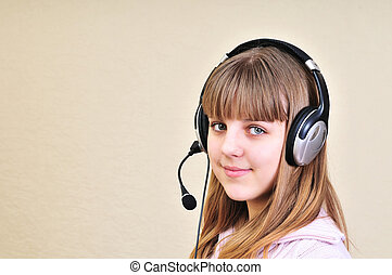 chatting girl - teenage girl in headphones chatting with...