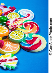 Colorful candies on blue background