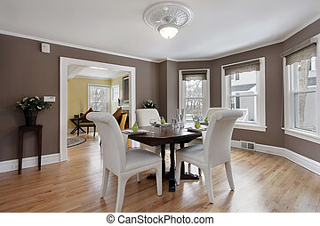 Dining room with wall of windows - Dining room in suburban...