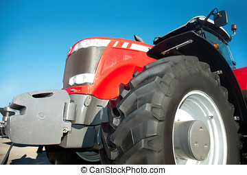 Red tractor against the clear blue sky
