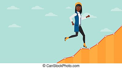 Business woman walking upstairs. - An african-american woman...