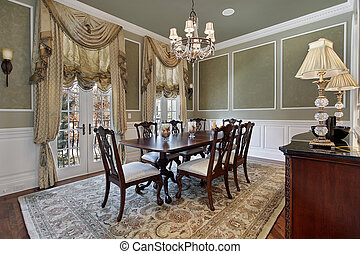 Dining room with french doors - Dining room in luxury home...