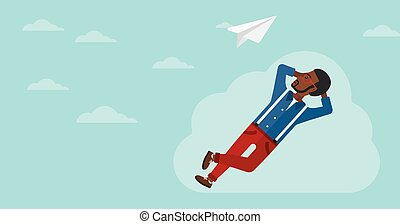 Businessman relaxing on cloud. - An african-american man...