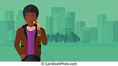 Man smoking cigar - An african-american man smoking a cigar...