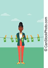 Woman loundering money - An african-american business woman...
