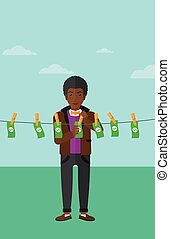 Man loundering money - An african-american businessman...